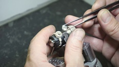 Master jeweler produces a silver ring  Stock Footage