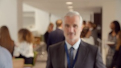 Portrait Of Mature Male Delegate During Break At Conference Stock Footage