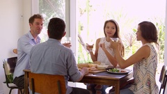 Group Of Friends Enjoying At Dinner Party Making A Toast Stock Footage