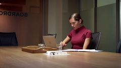 Young white businesswoman working late in office, close up shot  Stock Footage