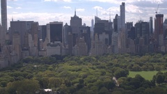 AERIAL: Flying above the Central park towards midtown Manhattan above 6th avenue Stock Footage