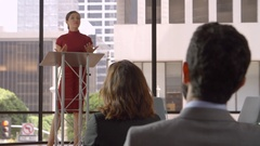 Audience applaud young woman speaking at a business seminar Stock Footage
