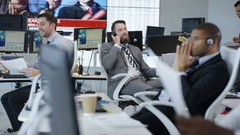 4K Busy room full of financial traders negotiating deals over the phone Stock Footage