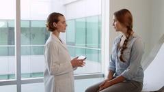Doctor Meets With Teenage Patient In Exam Room  Stock Footage