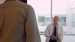 Doctor Meets With Male Patient In Exam Room  Stock Footage
