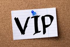 VIP - teared note paper pinned on bulletin board Stock Photos