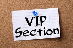VIP Section - teared note paper pinned on bulletin board Stock Photos