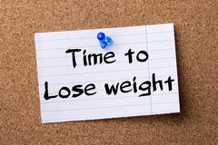Time to Lose weight - teared note paper pinned on bulletin board Stock Photos