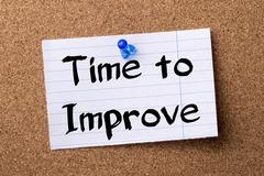 Time to Improve - teared note paper pinned on bulletin board Stock Photos