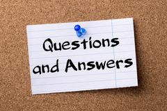 Questions and Answers - teared note paper  pinned on bulletin board Stock Photos
