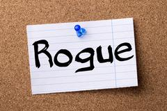 Rogue - teared note paper pinned on bulletin board Stock Photos