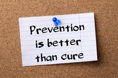 Prevention is better than cure - teared note paper  pinned on bulletin board Stock Photos