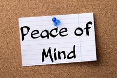 Peace of Mind - teared note paper pinned on bulletin board Stock Photos