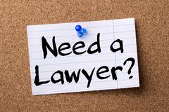Need a Lawyer? - teared note paper pinned on bulletin board Stock Photos