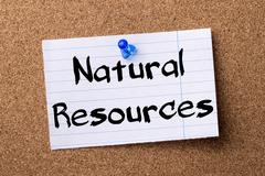 Natural resources - teared note paper pinned on bulletin board Stock Photos