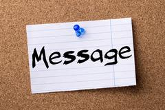 Message - teared note paper pinned on bulletin board Stock Photos