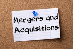 Mergers and Acquisitions - teared note paper pinned on bulletin board Stock Photos