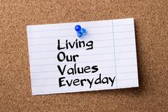Living Our Values Everyday LOVE - teared note paper pinned on bulletin board Stock Photos