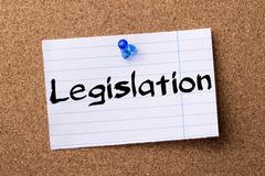 Legislation - teared note paper pinned on bulletin board Stock Photos