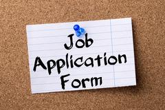 Job Application Form - teared note paper pinned on bulletin board Stock Photos
