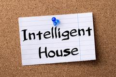Intelligent House - teared note paper pinned on bulletin board Stock Photos