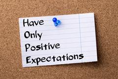 Have Only Positive Expectations HOPE - teared note paper pinned on bulletin.. Stock Photos