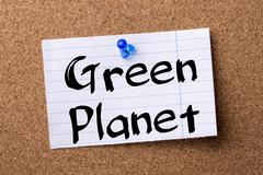 Green Planet - teared note paper pinned on bulletin board Stock Photos