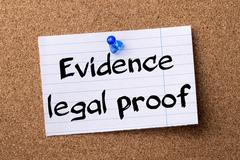 Evidence legal proof - teared note paper pinned on bulletin board Stock Photos