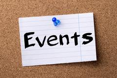 Events - teared note paper  pinned on bulletin board Stock Photos