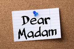 Dear Madam - teared note paper pinned on bulletin board Stock Photos