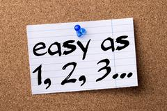 Easy as 1, 2, 3 - teared note paper pinned on bulletin board Stock Photos