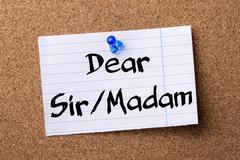 Dear Sir/Madam - teared note paper pinned on bulletin board Stock Photos