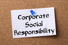 Corporate Social Responsibility CSR - teared note paper pinned on bulletin .. Stock Photos