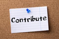 Contribute - teared note paper pinned on bulletin board Stock Photos