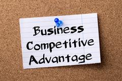 Business Competitive Advantage - teared note paper pinned on bulletin board Stock Photos