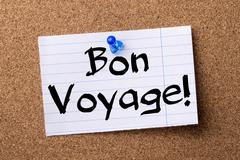 Bon Voyage! - teared note paper pinned on bulletin board Stock Photos