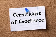 Certificate of Excellence - teared note paper pinned on bulletin board Stock Photos