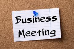Business Meeting - teared note paper  pinned on bulletin board Stock Photos