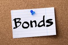 Bonds - teared note paper pinned on bulletin board Stock Photos
