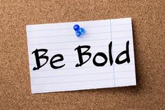 Be Bold - teared note paper pinned on bulletin board Stock Photos