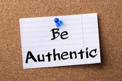 Be Authentic - teared note paper pinned on bulletin board Stock Photos