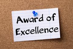 Award of Excellence - teared note paper pinned on bulletin board Kuvituskuvat