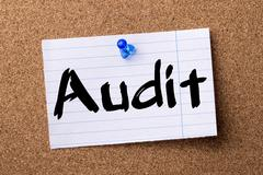 Audit - teared note paper pinned on bulletin board Stock Photos