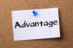Advantage - teared note paper pinned on bulletin board Stock Photos