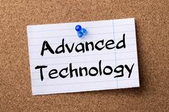 Advanced technology - teared note paper pinned on bulletin board Stock Photos