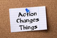 Action Changes Things ACT - teared note paper pinned on bulletin board Stock Photos