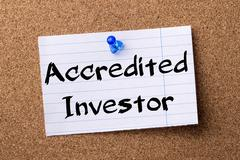 Accredited Investor - teared note paper pinned on bulletin board Stock Photos