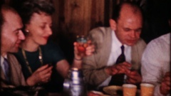 Smiles, conversation, food and drinking at party, 4029 vintage film home movie Stock Footage