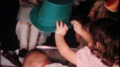 Children celebrate New Years Eve with horns and hats, 4030 vintage home movie Stock Footage