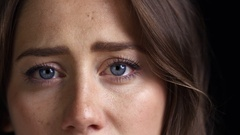Close Up Of Unhappy Young Woman Looking Sadly Into Camera Stock Footage